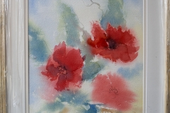 Poppies. A loose style of watercolour suggesting poppies, blowing in the wind.