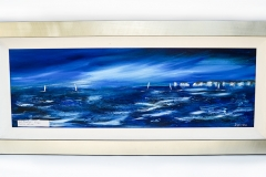 Dark Blue Sea 1. A pair of paintings in dark ultramarine blue, stunning frame picking out the silver leaf on the paintings.